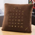 Brookstone Remote Control Pillow stuffed with a universal 6 in 1 remote control 1